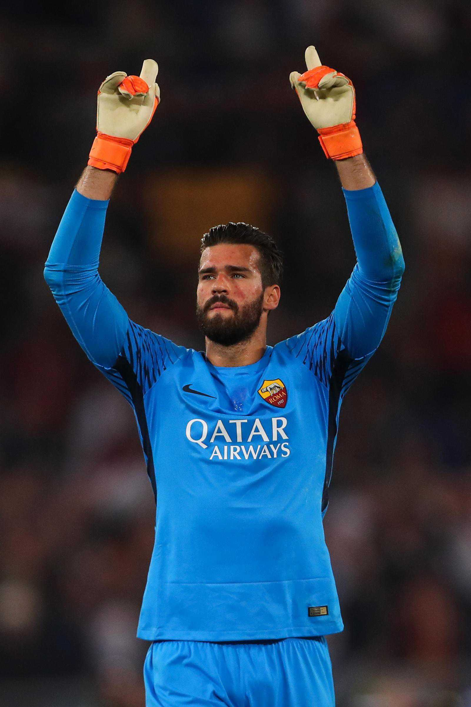 Scooper - Football News: tall story Alisson was too short