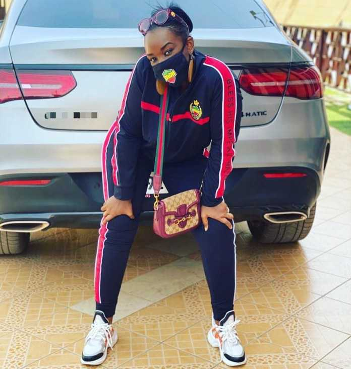 Stonebwoy's Wife Dr. Louisa Swags Up In A New Photo Wearing A 'Bhim Merch'
