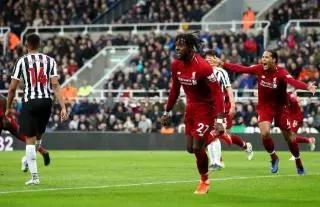 Divock Origi kept Liverpool's title hopes alive with the winner against Newcastle